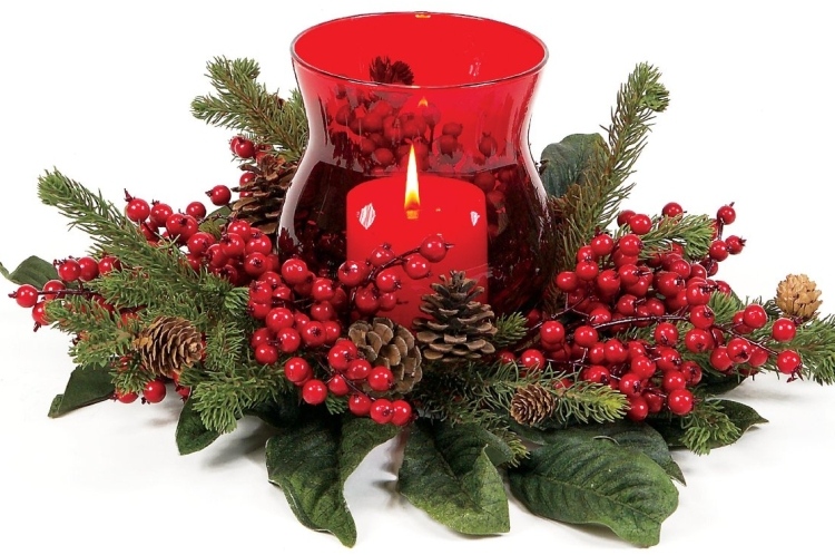 Candle centerpiece bursting with red berries christmas