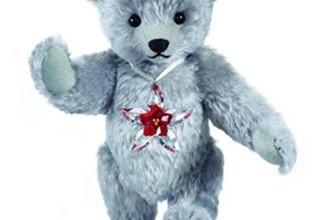 The Swarovski Teddy Bear Featuring the Swarovski Poinsettia Ornament