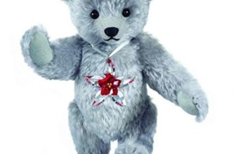 The Swarovski Teddy Bear Featuring the Swarovski Poinsettia Ornament